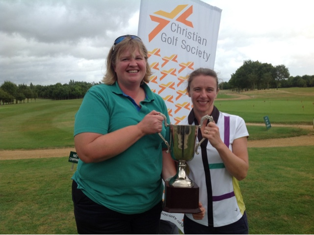 Eady and Mott hold golf trophy